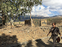 16. &quot;Female Soldier at Training Camp&quot;: military installation in the Golan Heights.<br />