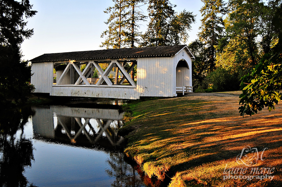 A covered bridge at sunset