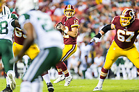 Landover, MD - August 16, 2018: Washington Redskins quarterback Colt McCoy (12) sits in the pocket during preseason game between the New York Jets and Washington Redskins at FedEx Field in Landover, MD. (Photo by Phillip Peters/Media Images International)