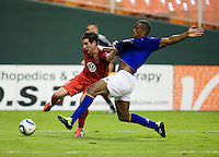 Chris Pontius (13) of D.C. United fights for the ball with Sylvain Distin (15) of Everton during their friendly match held at RFK Stadium in Washington, DC.  D.C. United lost to Everton, 3-1.