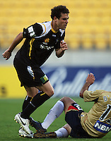Adam D'Apuzzo slides into a tackle on Daniel during the A-League match between Wellington Phoenix and Newcastle Jets at Westpac Stadium, Wellington, New Zealand on Sunday, 4 January 2009. Photo: Dave Lintott / lintottphoto.co.nz