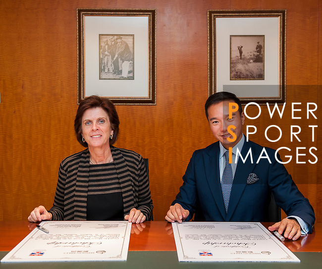 Professor Louise Richardson, Principal and Vice-Chancellor, University of St Andrews (L) and Tenniel Chu, Vice Chairman, Mission Hills Group (R) attend signature of the Mission Hills-St Andrews Scholarship Fund Agreement at Mission Hills offices on November 21, 2014 in Hong Kong, China. Photo by Xaume Olleros / Power Sport Images
