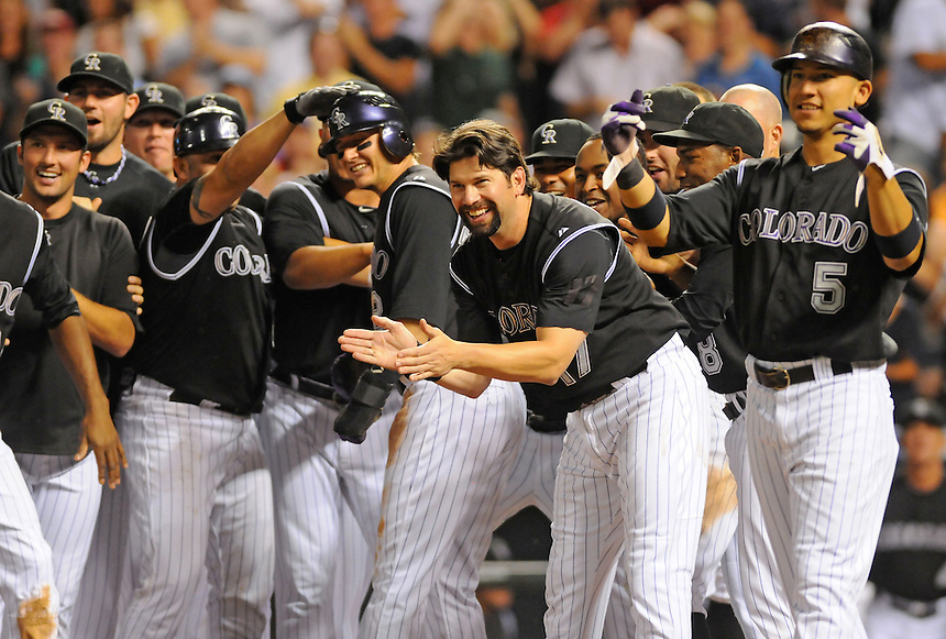 15 AUGUST 2011:   Colorado Rockies, including Colorado Rockies shortstop Troy Tulowitzki (2), Todd Helton, and Carlos Gonzalez celebrate as Colorado Rockies shortstop Troy Tulowitzki (2) scores a run on a walk off three run homerun  during a regular season game between the Florida Marlins and the Colorado Rockies at Coors Field in Denver, Colorado. The Rockies beat the Marlins 7-4. *****For Editorial Use Only*****