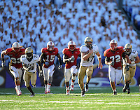 Navy's Paul Lariviere scrambles for extra yards. Maryland defeated Navy 17-14 at the M&T Bank in Baltimore, MD on Monday, September 6, 2010. Alan P. Santos/DC Sports Box