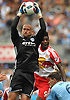 Josh Saunders #12, NYC Football Club goalie, makes a save during a Major League Soccer match against the New York Red Bulls at Yankee Stadium on Sunday, July 3, 2016. NYCFC won by a score of 2-0.