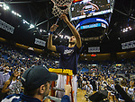Nevada's Kendall Stephens cuts down the net after their win over Colorado State for the Mountain West Championship in a NCAA college basketball game in Reno, Nev., Sunday, Feb. 25, 2018. (AP Photo/Tom R. Smedes)
