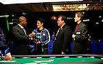The tournament staff of the Mohegan Sun Casino present the trophy to champion, Vanessa Selbst.