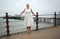 COPY BY TOM BEDFORD<br /> Pictured: Pat Stewart by original railing in Blackpool Promenade.<br /> Re: A pin-up girl from the 1950s has returned to the spot where she accidentally flashed her knickers and won the nation's hearts.<br /> Pat Stewart was a teenage dancer when she and a pal were persuaded to pose for a picture on Blackpool seafront.<br /> As the camera clicked a gust of wind lifted her skirt to give just a glimpse of forbidden flesh.<br /> Pat became known as the girl in the spotty dress and it helped kick-off her showbusiness career.<br /> And 65 years later Pat posed on the same spot after returning to Blackpool for the first time since the saucy snap was taken.£150 MINIMUM FOR NEWSPAPER USE PLEASE