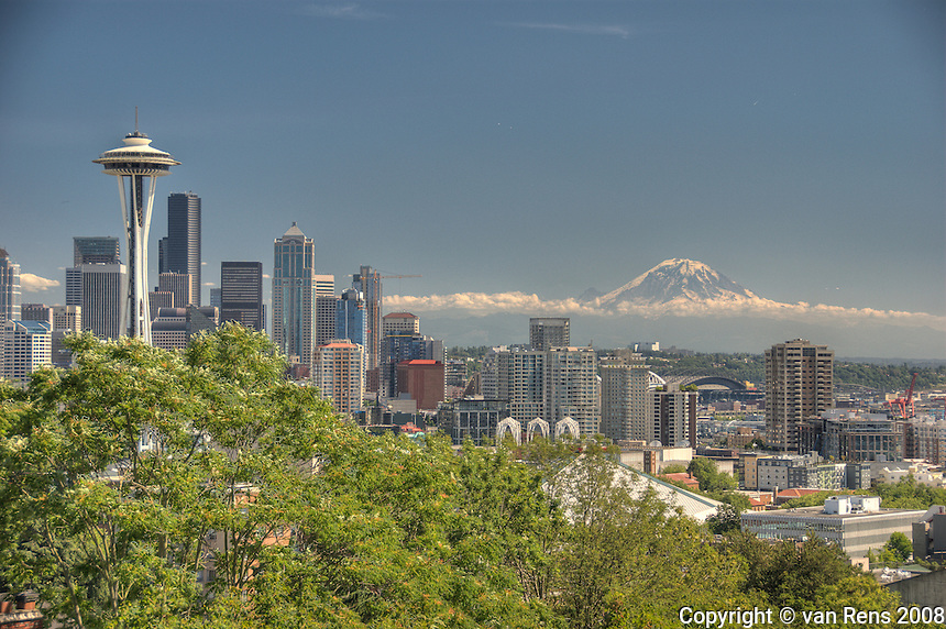 Mt Rainier seemingly flowing as a backdrop to Seattle, Washington.