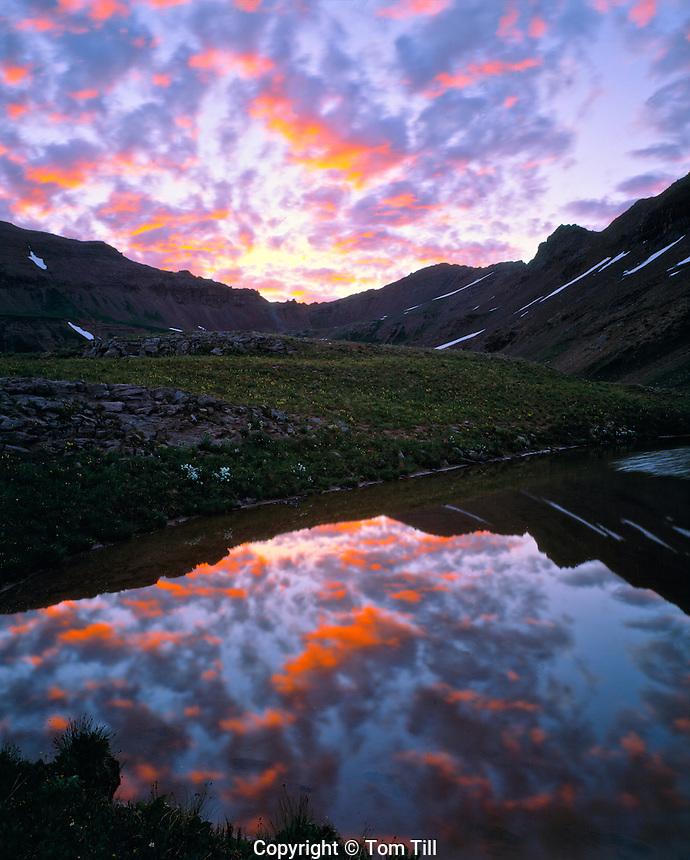 Sunrise in an alpine tarn     Maroon Bells/Snomass Wilderness, Colorado      West Maroon Pass    Elk Mountains    JUly