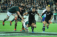 NZ's Richie Mo'unga is tackled during the Rugby Championship rugby union match between the New Zealand All Blacks and South Africa Springboks at Westpac Stadium in Wellington, New Zealand on Saturday, 27 July 2019. Photo: Mike Moran / lintottphoto.co.nz