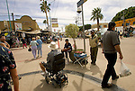 LOS ALGODONES, MEXICO-MARCH 24: Americans cross the main intersection of town  as they shop for perscription drugs or  visit one of hundreds of doctors, dentists, and opticians March 24, 2005 in Algodones. Thousands cross the border each day  seeking relief from the high cost of medican services and pharmaceuticals in the U.S. ©Radhika Chalasani