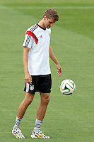 Thomas Muller of Germany warms up during training
