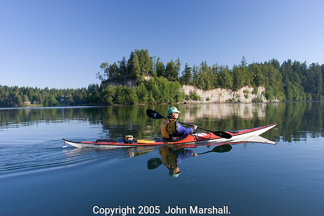 Henry Romer paddles a Anas Acuta sea kayak made by Valley in Britain.  Photo at Hammersley Inlet on Puget Sound.