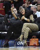MIAMI, FL - JANUARY 5: Gucci Mane (L) and his wife Keyshia Ka'Oir (R) watch the Miami Heat against the New York Knicks game at the America Airlines Arena on January 5, 2017 at American Airlines Arena in Miami, Florida  <br /> CAP/MPI122<br /> &copy;MPI122/Capital Pictures