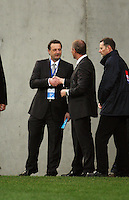 Phoenix CEO Tony Pignata shakes hands with coach Ricki Herbert before the match during the A-League football match between Wellington Phoenix and Perth Glory at Westpac Stadium, Wellington, New Zealand on Sunday, 16 August 2009. Photo: Dave Lintott / lintottphoto.co.nz