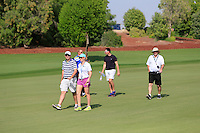 Alan Lowry, Kate Whyte and friends walking down the 10th fairway during the preview for the DP World Tour Championship at the Earth course,  Jumeirah Golf Estates in Dubai, UAE,  18/11/2015.<br /> Picture: Golffile | Thos Caffrey<br /> <br /> All photo usage must carry mandatory copyright credit (&copy; Golffile | Thos Caffrey)