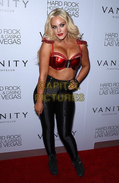 Lacey Schwimmer.Lacey Schwimmer hosts Vanity Nightclub at Hard Rock Hotel and Casino, Las Vegas, Nevada, USA..August 6th, 2011.full length black red spandex leggings red cropped top belly stomach midriff boots hand on hip cleavage .CAP/ADM/MJT.© MJT/AdMedia/Capital Pictures.