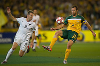 MELBOURNE, AUSTRALIA - MAY 24, 2010: Lucas Neill of the Qantas Socceroos beats Shane Smeltz of New Zealand to the ball at the FIFA World Cup farewell match between Australia and New Zealand at the Melbourne Cricket Ground, 24 May, 2010 in Melbourne, Australia. Photo by Sydney Low / www.syd-low.com