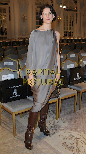 Maria Grachvogel .London Fashion Week, Covent Garden, London, England..September 16th, 2011.LFW full length brown boots silk satin dress one sleeve grey gray. CAP/WIZ.© Wizard/Capital Pictures.