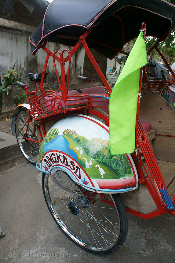 Bemo (three wheel taxi) with colourful painting and green flag, Yogyakarta, island Java, archipelago of Indonesia,  September 2011