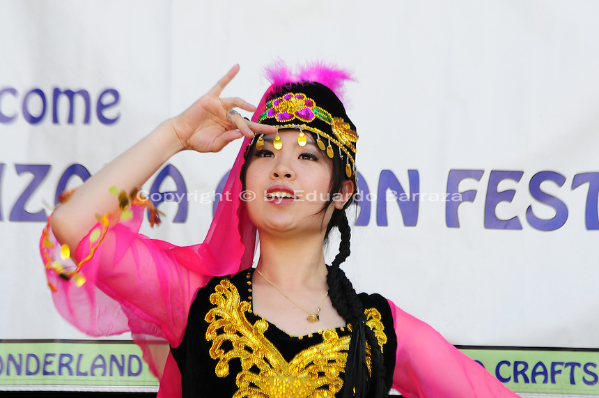 Mesa, Arizona. November 4, 2012 - A Chinese dancer presented a Xinjiang (Uyghur) Ethnic Minority dance at the 18th annual Asian Festival 2012. In Arizona, Asian-Americans celebrated a colorful festival where their rich culture was admired and their growing presence affirmed. Asian-Americans are now the United States fastest-growing racial group, the best-educated and highest-earning workers. Photo by Eduardo Barraza © 2012