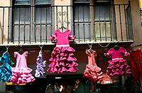 Flamenco dresses, hanging from balcony.Granada, Andalucia, Spain.