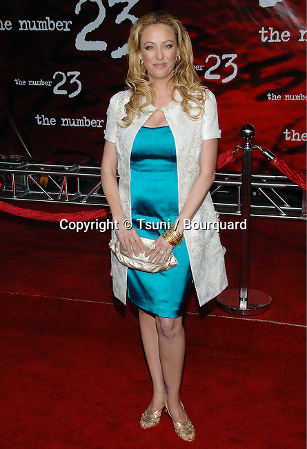 Virginia Madsen arriving at the he NUMBER 23 Premiere at the Orpheum Theatre In Los Angeles.<br /> <br /> full length<br /> eye contact<br /> turquoise dress<br /> white jacket