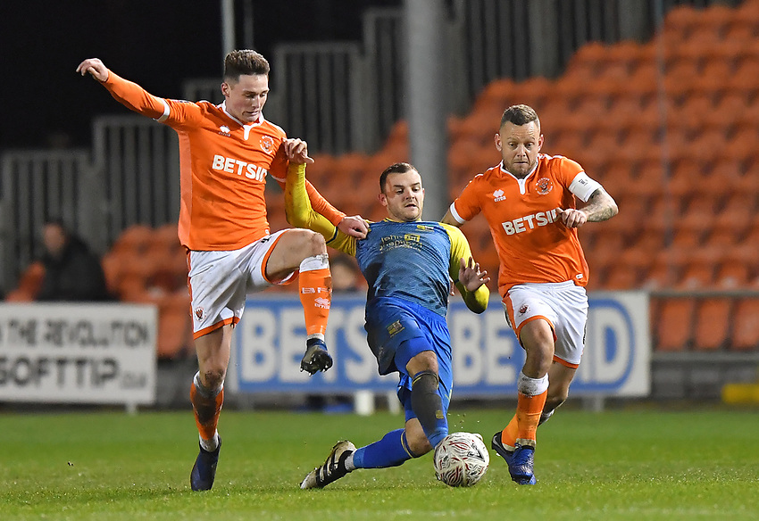 Blackpool's Jordan Thompson (left) and Jay Spearing (right) battle for the ball<br /> <br /> Photographer Dave Howarth/CameraSport<br /> <br /> The Emirates FA Cup Second Round Replay - Blackpool v Solihull Moors - Tuesday 18th December 2018 - Bloomfield Road - Blackpool<br />  <br /> World Copyright © 2018 CameraSport. All rights reserved. 43 Linden Ave. Countesthorpe. Leicester. England. LE8 5PG - Tel: +44 (0) 116 277 4147 - admin@camerasport.com - www.camerasport.com