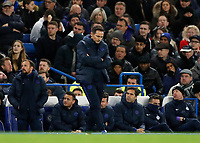 30th November 2019; Stamford Bridge, London, England; English Premier League Football, Chelsea versus West Ham United; Chelsea Manager Frank Lampard looking down onto the pitch disappointed from the touchline while his coaching staff look on from the dugout  - Strictly Editorial Use Only. No use with unauthorized audio, video, data, fixture lists, club/league logos or 'live' services. Online in-match use limited to 120 images, no video emulation. No use in betting, games or single club/league/player publications