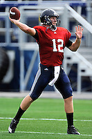 7 August 2011:  FIU's Jake Medlock (12) passes during drills as part of the first day of fall practice with full pads at University Park Stadium in Miami, Florida.