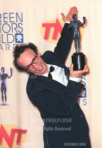 07MAR99: Actor ROBERTO BENIGNI at the Screen Actors Guild Awards where he won the award for Best Movie Actor..© Paul Smith / Featureflash