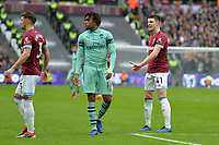 Alex Iwobi of Arsenal and Aaron Cresswell of West Ham United and Declan Rice of West Ham United during West Ham United vs Arsenal, Premier League Football at The London Stadium on 12th January 2019
