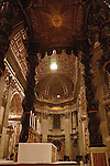 ( Interior of St. Peter's Basilica / Mass ).Gian Lorenzo Bernini designed this circular plaza in the 17th Century with an eye for dramatic dark narrow medieval streets, fountains and a wide open piazza which presides over St. Peter's Basilica in Vatican City, Rome, Italy..January 2005.