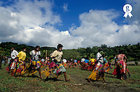Group of faithfuls of the John Frum cargo cult movement dancing for the February 15th celebration, Sulphur bay village, Tanna Island, Vanuatu (Licence this image exclusively with Getty: http://www.gettyimages.com/detail/82064700 )