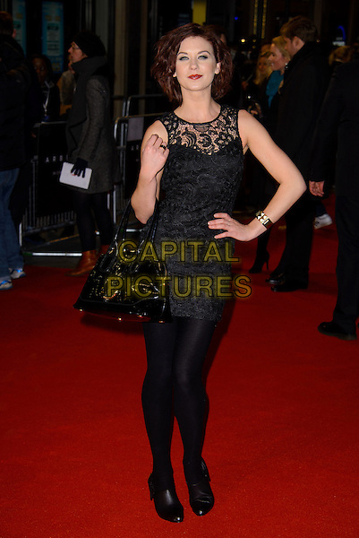 "Natasha Leigh.The ""Arbitrage"" UK film premiere, Odeon West End cinema, Leicester Square, London, England..February 20th 2013.full length black lace dress bag patent hand on hip .CAP/CJ.©Chris Joseph/Capital Pictures."