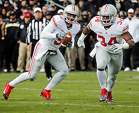 Ohio State Buckeyes quarterback Braxton Miller (5) and running back Carlos Hyde (34) move the ball upfield during the first half of the NCAA football game against Purdue at Ross-Ade Stadium in West Lafayette, Ind. on Nov. 2, 2013. (Adam Cairns / The Columbus Dispatch)