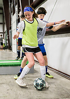 """NWA Democrat-Gazette/CHARLIE KAIJO Hailey Crabb, 11, of Bentonville (center) plays a one-versus one with Caleb Crusinbery, 12, of Centerton (right) during a three-day New Year's Soccer Camp, January 4, 2019 at Strike Zone Training Academy in Rogers. <br /><br />The Specialized Soccer Academy hosted a three-day soccer camp to help build confidence in young athletes.<br /><br />""""If they build confidence in a sport they feel like they have something that's theirs,"""" said Coach Sarita Saavedra. """"They help themselves get better and that translates to confidence in the classroom or anything.""""<br /><br />The kids worked on juggling skills, one-versus-one practice and scrimmages."""