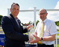 Connections of Neshmeya trained by Charles Hills receive their trophy for winning winning The Wateraid Mildren Construction Maiden Fillies' Stakes (Plus 10),a during Father's Day Racing at Salisbury Racecourse on 18th June 2017