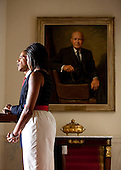 Washington, DC - July 27, 2009 -- United States President Barack Obama speaks at a reception for ambassadors as First Lady Michelle Obama watches at the White House in Washington, D.C., U.S., Monday, July 27, 2009.   .Credit: Joshua Roberts / Pool via CNP