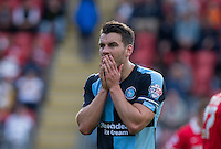 Matthew Bloomfield of Wycombe Wanderers can't believe a decision during the Sky Bet League 2 match between Leyton Orient and Wycombe Wanderers at the Matchroom Stadium, London, England on 19 September 2015. Photo by Andy Rowland.