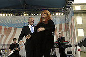 Country music singer Wynonna Judd makes her stage entrance after an introduction by United States Secretary of Defense Donald H. Rumsfeld at the Pentagon on May 21, 2004.  Judd performed for an audience of military and Department of Defense (DoD) civilians that included military personnel recovering from wounds received in Iraq and Afghanistan.  .Mandatory Credit: Helene Stikkel / DoD via CNP