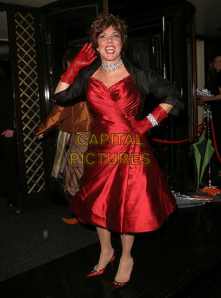 RUBY WAX.The Orange British Academy Film Awards aftershow & Grosvenor House Hotel, London, UK..February 19th, 2006.Ref: AH.full length red silk satin dress black jacket bracelet gloves hand on hip waving.www.capitalpictures.com.sales@capitalpictures.com.© Capital Pictures.