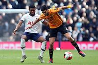 Raul Jimenez of Wolverhampton Wanderers and Japhet Tanganga of Tottenham Hotspur during Tottenham Hotspur vs Wolverhampton Wanderers, Premier League Football at Tottenham Hotspur Stadium on 1st March 2020