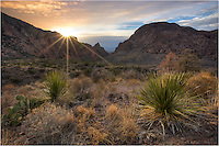 At the Window View in the heart of Big Bend National Park, the sun drops into the valley at sunset. This image was captured in late  March on a perfect evening in the Chisos Mountain range.