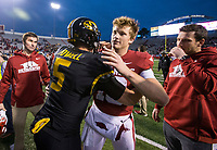 Hawgs Illustrated/BEN GOFF <br /> Jack Lindsey (18), Arkansas quarterback, greets Taylor Powell, Missouri quarterback, as Austin Allen looks on Saturday, Nov. 29, 2019, after the game at War Memorial Stadium in Little Rock. All three played at Fayetteville High.