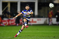 Jeff Williams of Bath Rugby puts boot to ball. Anglo-Welsh Cup match, between Bath Rugby and Gloucester Rugby on January 27, 2017 at the Recreation Ground in Bath, England. Photo by: Patrick Khachfe / Onside Images