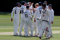 Callum Taylor (centre) celebrates taking a wicket during Essex CCC 2nd XI vs Surrey CCC 2nd XI, Second XI Championship Cricket at Billericay Cricket Club on 16th May 2017