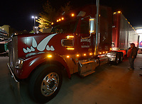 NWA Democrat-Gazette/ANDY SHUPE<br />Jerry Rico of Fayetteville and Rodney Collins prepare a semi-truck Thursday, Nov. 9, 2017, before heading out to Baton Rouge, La., ahead of the Razorbacks' game with LSU Saturday. Rico and coworker Rodney Collins are employees of J.B. Hunt Transport and the work together to drive equipment necessary for the Razorbacks football team to and from games away from Fayetteville.