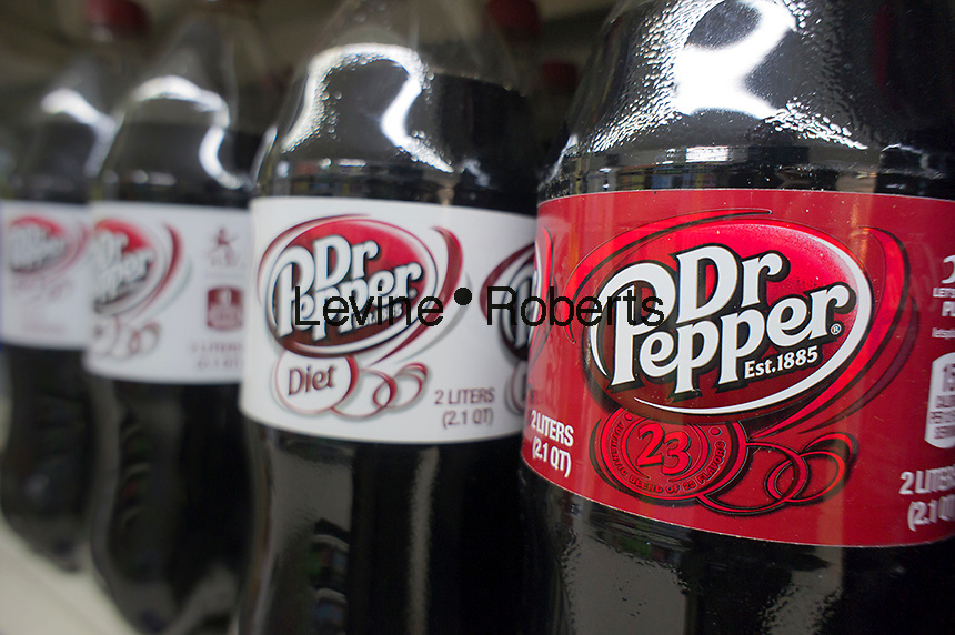 Bottles of Dr. Pepper soda on a supermarket shelf in New York on Friday, February 17, 2012.  The Dr. Pepper Snapple Group recently announced that its income for the fourth quarter rose 48 percent citing an increase in retail prices and the popularity of its citrus flavored beverage, Sun Drop. (© Richard B. Levine)